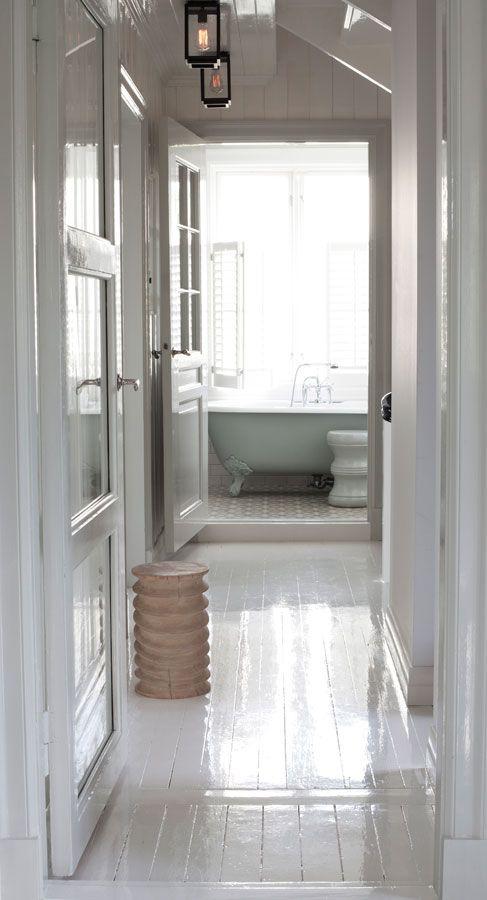 gloss white painted plank floors