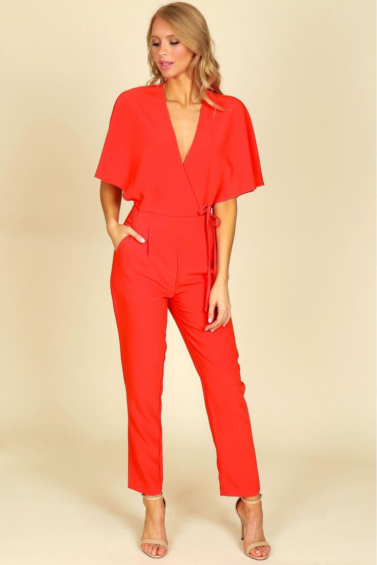 Wrap Jumpsuit Tomato, A gorgeous every occasion jumpsuit with a fax wrap front, v-cut neckline, a pleated waistline, and two side pockets.