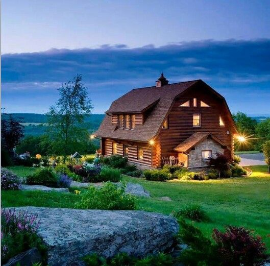 A Barn Converted Into A Log Cabin Home And The Scenery