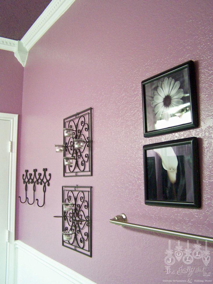 Our purple guest bathroom-towel rack, artwork, ceiling
