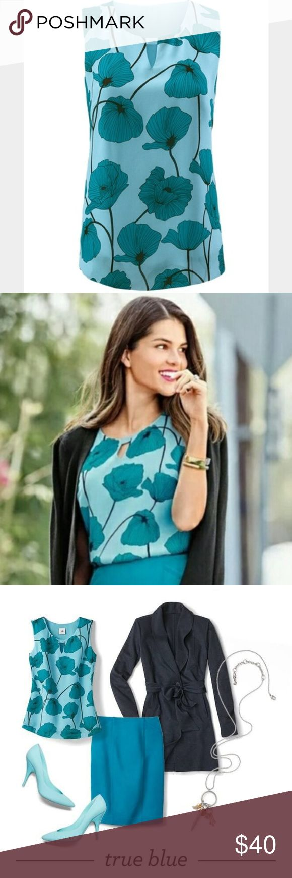 CAbi Blue Poppy Tank Keyhole Top Size XS Up for sale Cabi Poppy Tank.In cool shades of teal and cerulean, this ultra-soft tank can lean casual for daytime or romantic for evening. The Poppy Blouse features a keyhole neckline and an alluring floral print.  Sz XS CAbi Tops Blouses