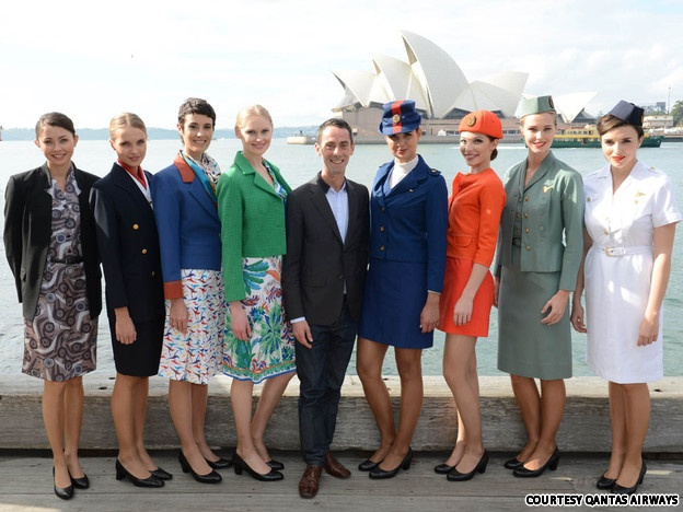Qantas Airways uniforms through the years    From right to left, flight attendant uniforms from the 1950s to the present. It's not hard to spot where the 1960s start. The latest uniform (far left) was designed by Australian fashion designer Martin Grant (middle), and is meant to reflect Australia's ethnic diversity.