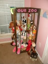 "stuffed toy storage - a ""zoo"" for stuffed animals made with a wooden frame and bungee cording"