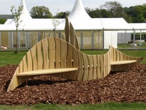 Wave and Splash (a 20 ft sculptural bench in tulipwood) was the centre piece at the Guardian Hay Festival 2009  This is an example of how we create sculptural, yet functional, garden furniture  You can view the reception of this innovative application of tulipwood as a show wood at Hay, on this youtube clip.
