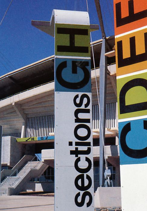 Gordon Andrews was an Australian designer who worked closely with Philip Cox & Partners to develop a complementary program of signage for the National Athletics Stadium in Canberra.