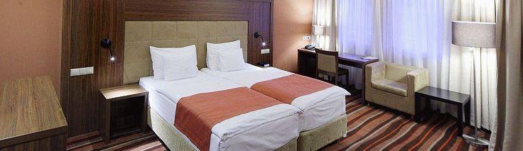 A szálloda Pécs zöldövezetében, az orvosegyetem klinikái szomszédságában. Különböző besorolású, panorámás utcai és belső kertre néző szobatípus szerepel a kínálatban. Minden szállodai szoba klimatizált és terasszal rendelkezik. A szálláshoz 150 fős étterem, többféle méretű és kialakítású konferenciaterem, számos sport- és wellness szolgáltatás áll a vendégeink rendelkezésére... HOTELSTARS minősített szálloda!