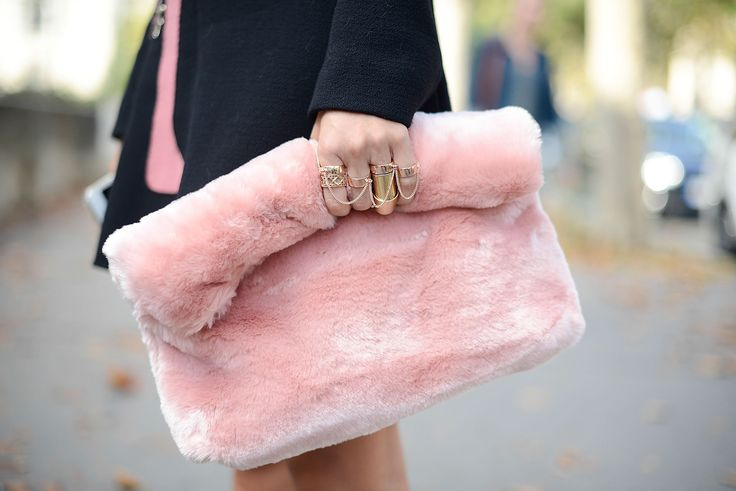 Paris Fashion Week: A Topshop handbag looked totally luxe clutched by a set of gold rings.