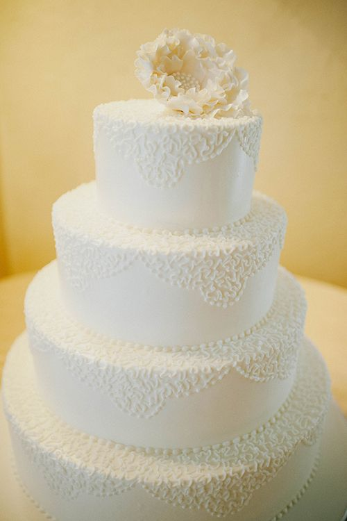 White #weddingcake with a sugar peony | @dianazapata | Brides.com
