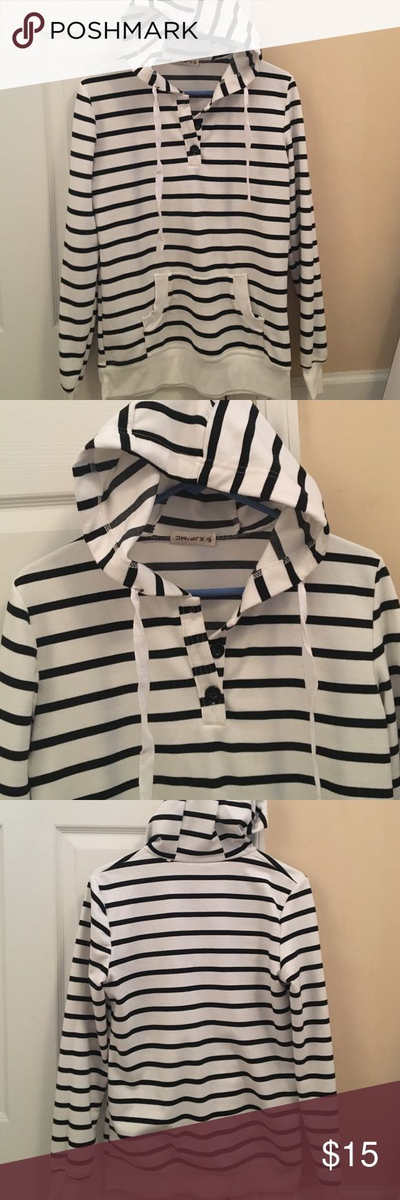 Black and white striped hoodie Black and white striped hoodie with 3 buttons at the top. Excellent condition! Size M. From an online boutique. Tops Sweatshirts & Hoodies