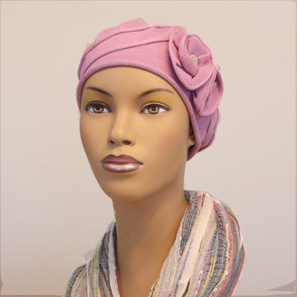 Darling Dahlia Beret. OMG, is this the most darling little beret you've ever seen? We've taken our classic French beret and added a double flower accent and a swirl detail for shape and pizazz. Full coverage, no inside seams, 100% soft, breathable cotton make this a wonderful hat for cancer patients and women with medical hair loss.