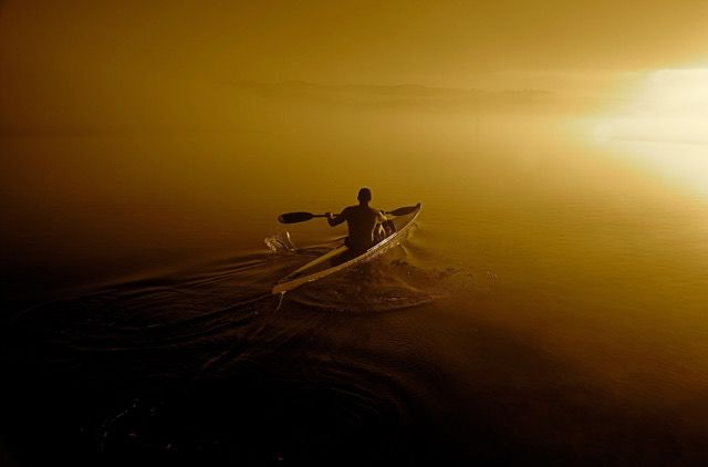 Paddling Into The Dawn