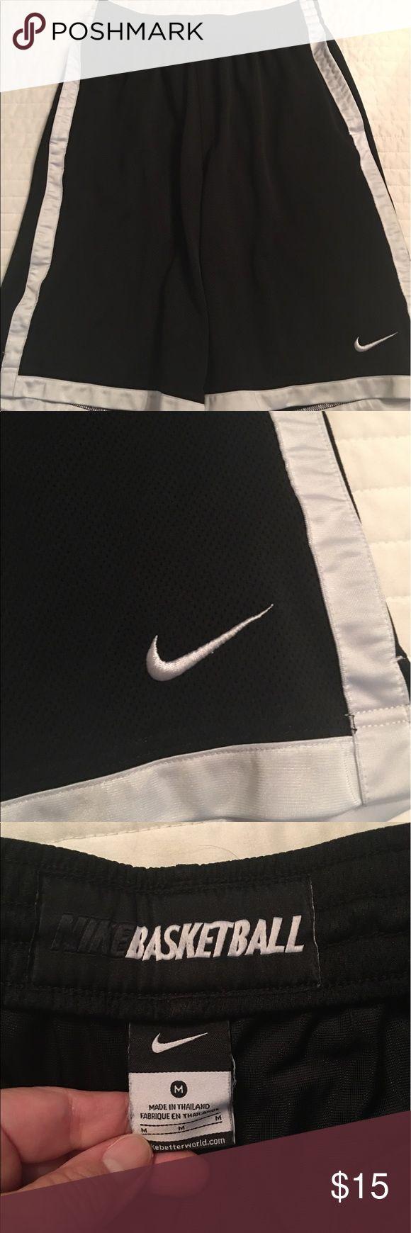 Men's Nike basketball shorts Black Nike basketball shorts with white piping. EUC. Nike Shorts Athletic