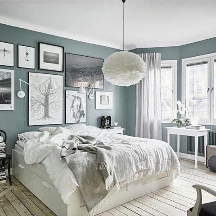 Light floorboards & grey bedroom
