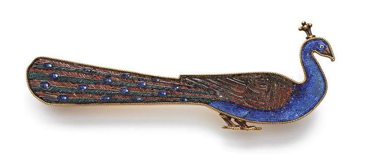 A Gold and Micromosaic Peacock Brooch by Castellani, decorated with mutli-coloured tesserae within a gold mount, the border finished with a gold ropetwist, the feet and plume also fashioned from twisted gold wire. Rome, circa 1870.