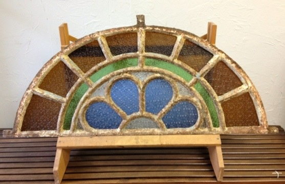 Great arched iron and colored glass window at WSA  http://tandemantiques.com/wp-content/uploads/2012/08/20120804-071559.jpg