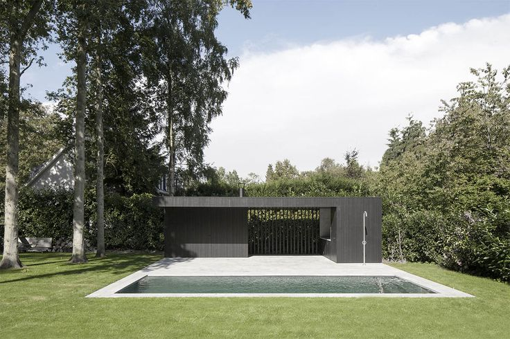 Uncomplicated and beautifully detailed pool house by Rolies + Dubois architecten.