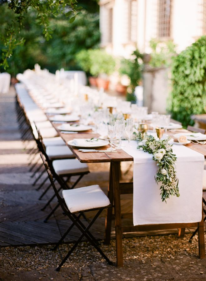 Tuscan villa outdoor wedding decor: http://www.stylemepretty.com/2017/02/23/tuscan-villa-wedding-featuring-a-dreamy-family-style-reception/ Photography: Vasia - http://www.vasia-weddings.com/