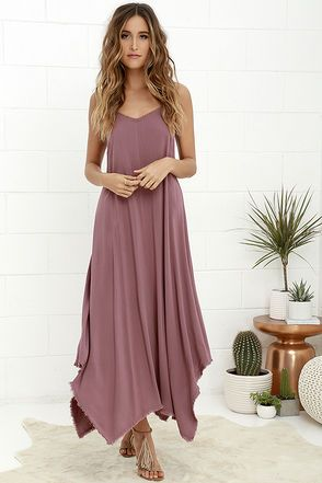 For a look that would make Simba proud, slip on the Others Follow Kiara Mauve Maxi Dress and let out a roar! Woven rayon, in a deep mauve hue, shapes a relaxed-fit bodice with cute crochet trim along the V-neckline. Twin spaghetti straps tie at back above a keyhole accent. Long, sweeping, maxi skirt ends in a fringe hem.