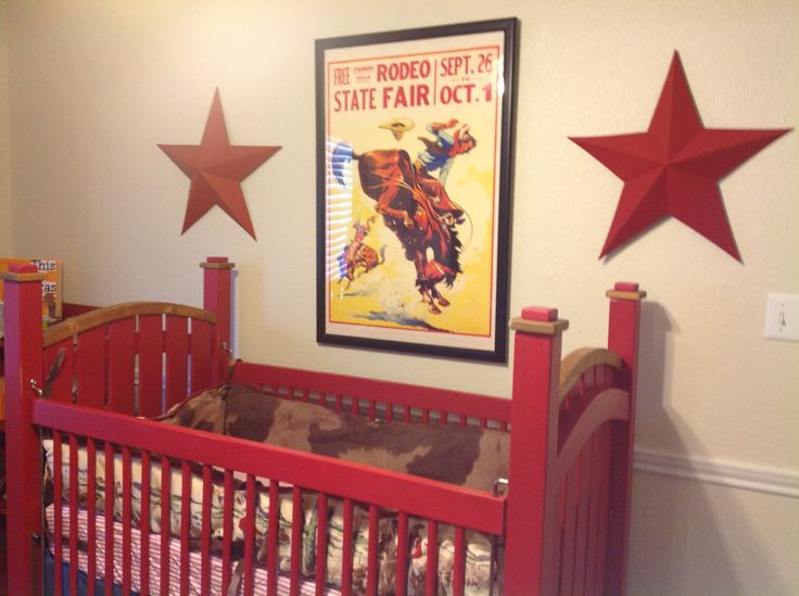 """Texas Cowboy Nursery - Our little cowboy's momma fell in love with this vintage rodeo poster and it became one of our inspiration pieces for the room. Shout out to Ebay seller """"artscape_galleries"""" for offering up this poster! The large metal stars were purchased at Hobby Lobby and painted with Annie Sloan chalk paint."""