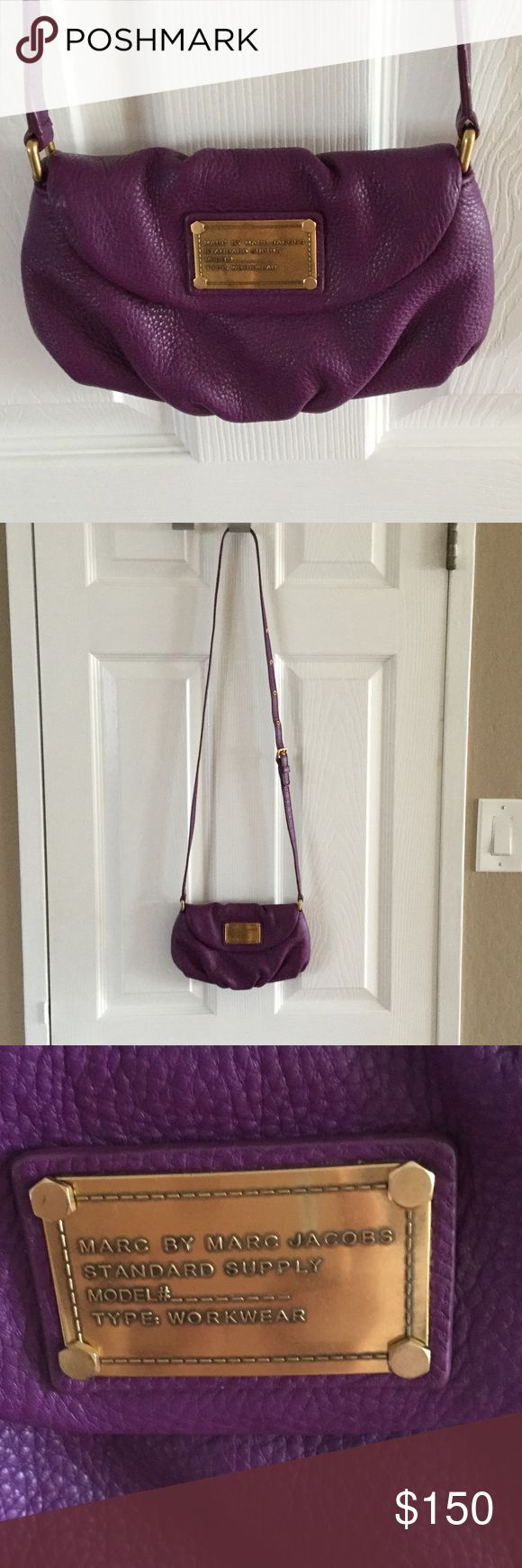 Marc Jacobs classic Karlie in purple This Karlie has the classic MJ black and white interior lining. This Karlie is the Bloomingdales version which means it does not come with the built in credit card slots and it's a leather strap instead on chain.  It is in excellent condition with no stains or wear and tear inside or out. Marc by Marc Jacobs Bags