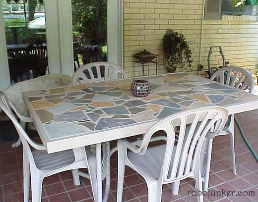 I can definitely replace my broken glass top table with a mosaic tile top like this!  Love it!