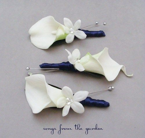 Simple and eloquent.  Could go with white lily, mint accent flower, and black ribbon.