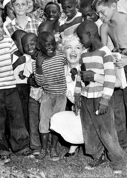 Marilyn Monroe visiting orphans on August 31, 1952