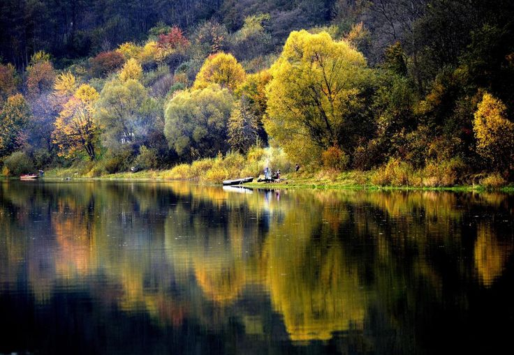 Autumn leaf colored trees are reflected in the waters of Lake Solina in Chrewt, Poland, Oct.12. Lake Solina is an artificial lake in the Bieszczady Mountains region. (Darek Delmanowicz/EPA)