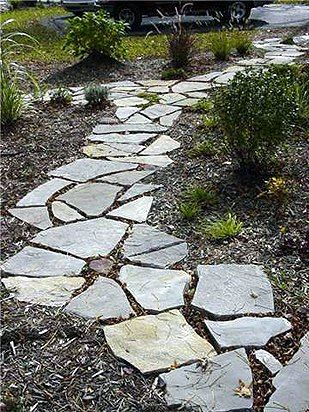 flagstone with mulch - backyard walkway idea