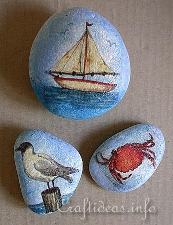 - round smooth rocks (if possible they should be light colored)  - paper napkin with sea side motifs such as the ones you see above  - decoupage glue for paper napkins or Modge Podge glue  - soft flat paint brush for applying paper napkin glue  - acrylic paint matching napkin (here a light blue paint was used)  - sponge for dabbing paint onto the stone