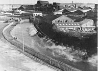 """St Helens, Merseyside - Wikipedia, the free encyclopedia Steam rises from """"The Hotties"""" in St Helens town centre in the 1970s, water warmed by the Pilkingtons factory was pumped into the canal via the """"gusher"""" and was warm enough to support tropical fish. The canal is still a popular fishing site."""