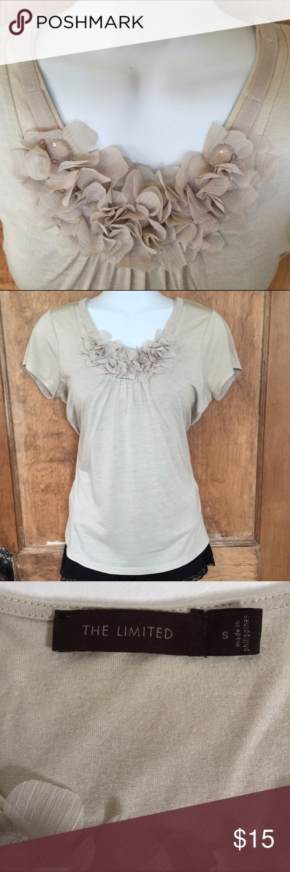 Lovely Layering Tee Simple beige tee with gorgeous ribbon detail at neck and floral/beaded detail at bottom of neckline. So pretty, wear alone or under a jacket or cardi. Super soft fabric. EUC, like new.  100% modal, care instructions in pic 4.  No trades please ❤️💕❣ The Limited Tops Tees - Short Sleeve