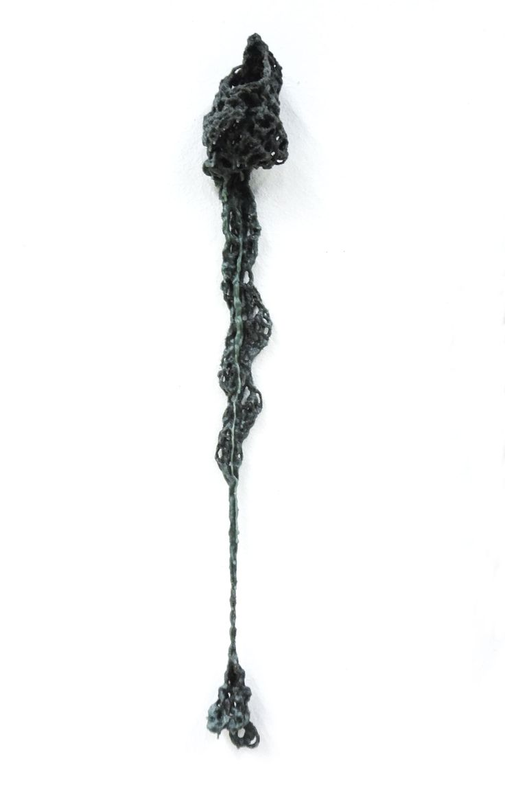 Waxing, Waning III by Kristin Roach: Beeswax, recycled candles, wool