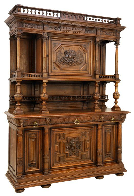 A HENRI II WALNUT BUFFET WITH CARVED DRAGON AND PAN : Lot 116