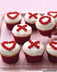 cute idea to top my favorite red velvet cupcakes, was think of making these but instead of OX writting out John 3:16 .@Kathy Chan Moore the kids would love these!