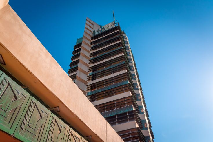 The Frank Lloyd Wright-designed Price Tower rises into the blue sky over Bartlesville Oklahoma.  See more #photos at 75central.com