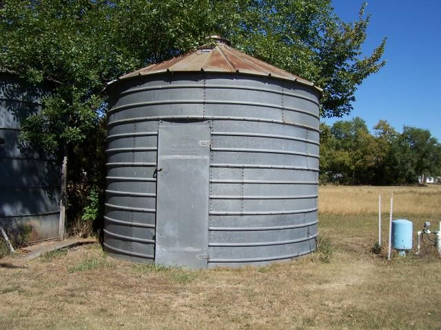 Fun idea for water pump etc shed. Painted all white to match the house. Thinking of an awesome F to go on the door. GRAIN BINS FOR SALE