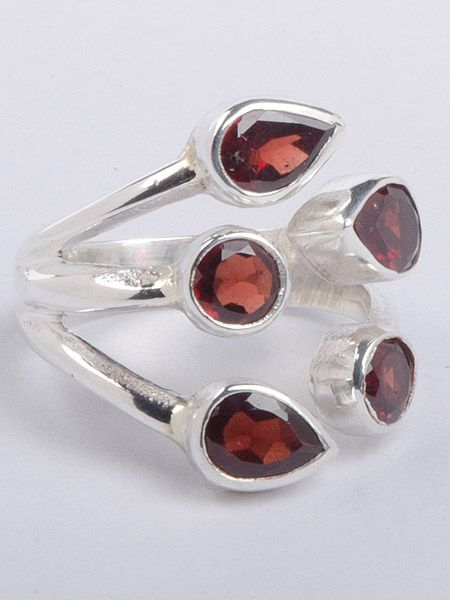 Lovely semi precious stone silver ring hand cut in Nepal This ring is guaranteed 925 silver. Garnet stone