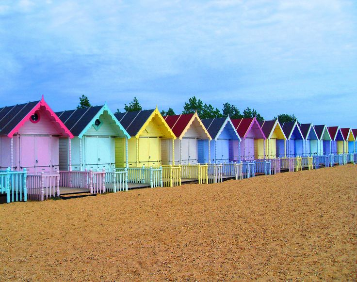 This photograph of beach huts positioned in a long line looks very traditional and original. Each beach is positioned in an orderly fashion and each positioned next to similar shaded colours. Although each of the beach huts is painted a different colour, light pastel shades of each colour have been used creating a blending effect.
