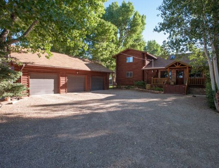 Directions Lund to 2800 N.- go west to 3800 W, go North to the end of the road on the West side.  Property Details Naturalist paradise! Enjoy tinkering in the workshop, barn or just enjoying the patio or covered deck. Nice main log home has 4 bedrooms possible fifth currently used as a game room & family  room. 3.5 baths. Main level rock framed fireplace & basement wood burning fireplace. Full appliance package. Self sufficient one bedroom guest cottage has it's own laundry & ...
