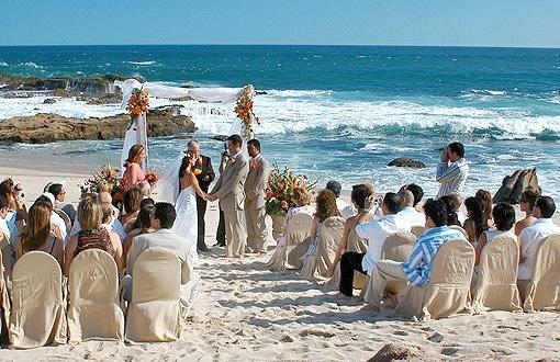 Wedding ceremony taking place on the beach at Esperanza Resort in Cabo, Mexico. Beautiful!  http://www.esperanzaresort.com