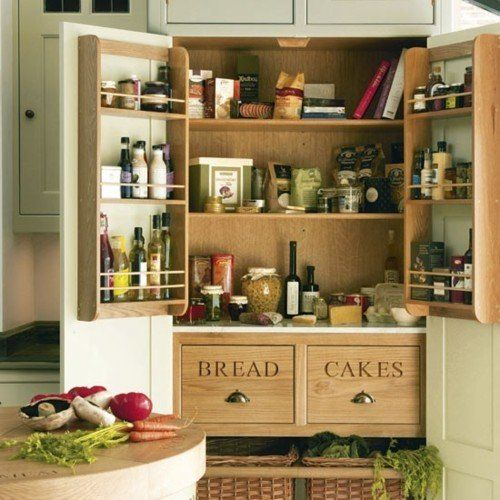 freestanding armoire transformed into a pantry with added shelving & baskets