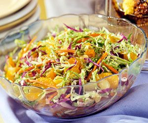 Cut the preparation time by starting with a bag of shredded cabbage with carrot. Let pineapple and Mandarin oranges make a colorful contribution to this quick and easy salad.