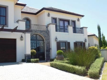 Val de Vie Estate lakeside Villa offering exquisite Architecture and true sophisticated country living.