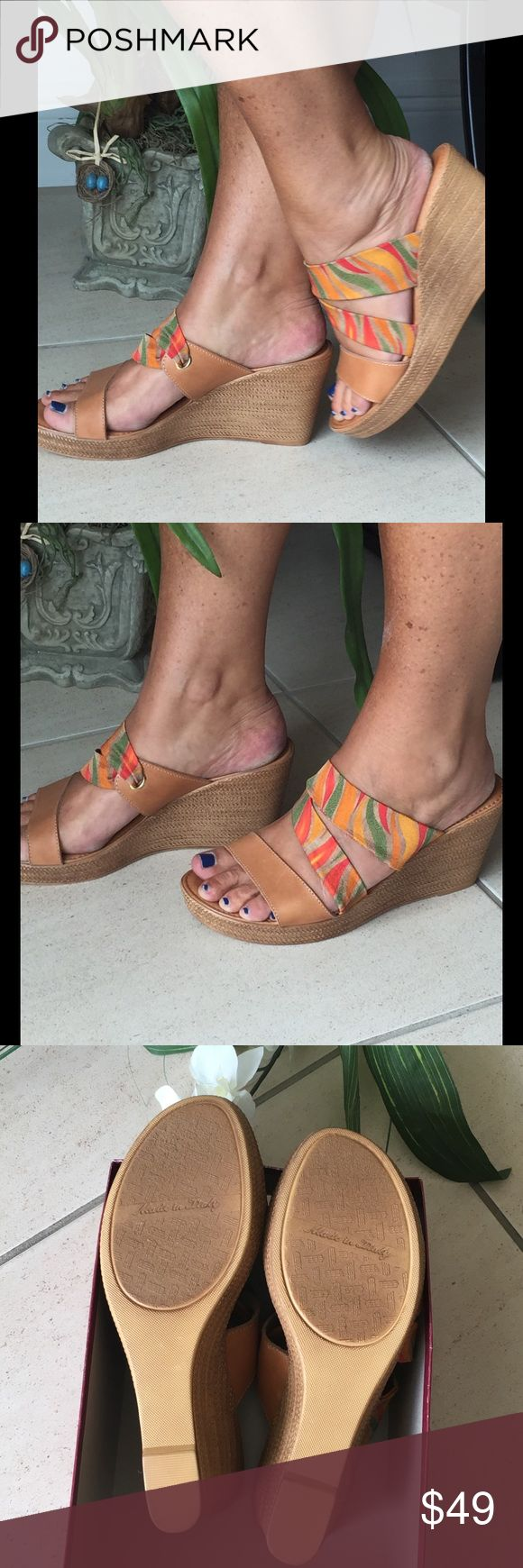 Tan, orange, pink & green espadrille wedge, sz 9.5 Super comfy, vibrant multi color espadrille wedges. Sid s look like straw, but are actually plastic.  Heal is 4 & 1/2 inches, platform at toe is 1 inch. Super cute with jeans, shorts, etc. New, never worn, box but no tags. Size 9.5 but comfortable for my size 10 feet. Shoes Espadrilles