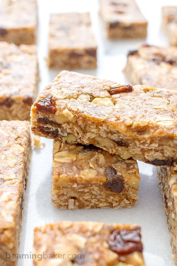 No Bake Oatmeal Raisin Granola Bars (Vegan + Gluten Free): Soft and chewy granola bars that taste just like an oatmeal raisin cookie. An easy Vegan and Gluten Free recipe made with whole ingredients.