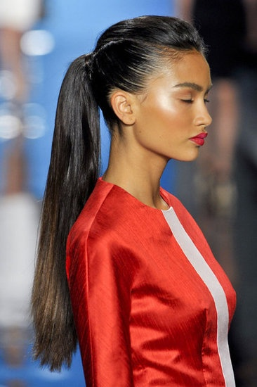 Reem Acra:  ponytails looked elegant paired with bold red lipstick.