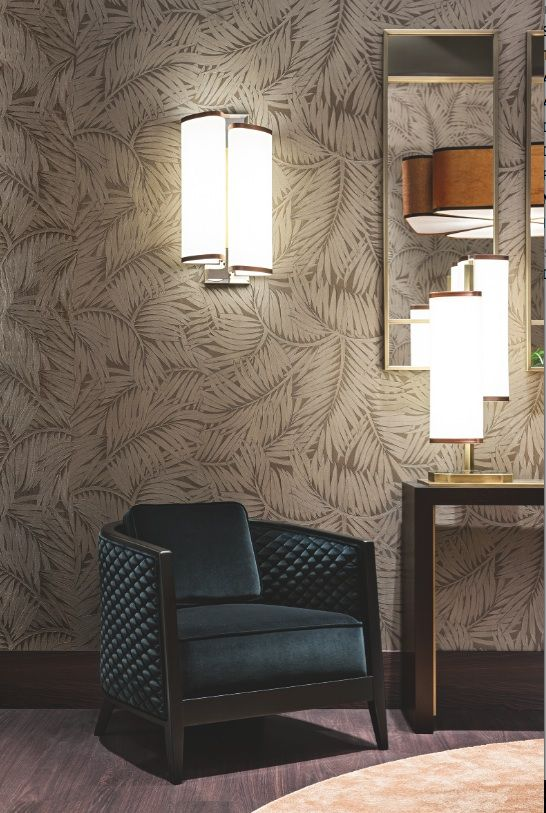 Detail of the Autumn Leaves room by Oasis, with Saten armchair, Khan console and table and wall Flower lamps.