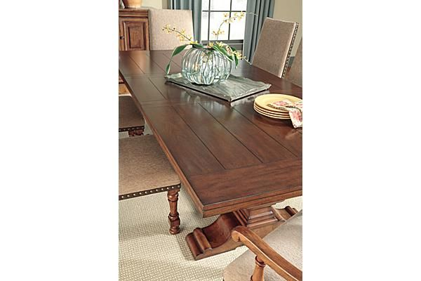 the gaylon extension pedestal dining table from ashley