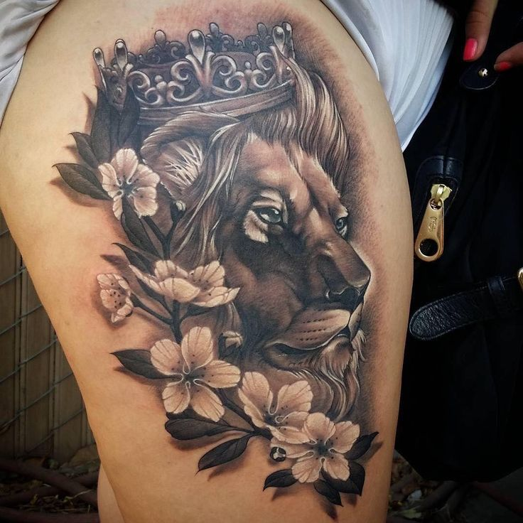 Lion tattoo with flowers